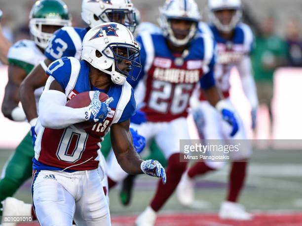 Running back Stefan Logan of the Montreal Alouettes runs with the ball against the Saskatchewan Roughriders during the CFL game at Percival Molson...