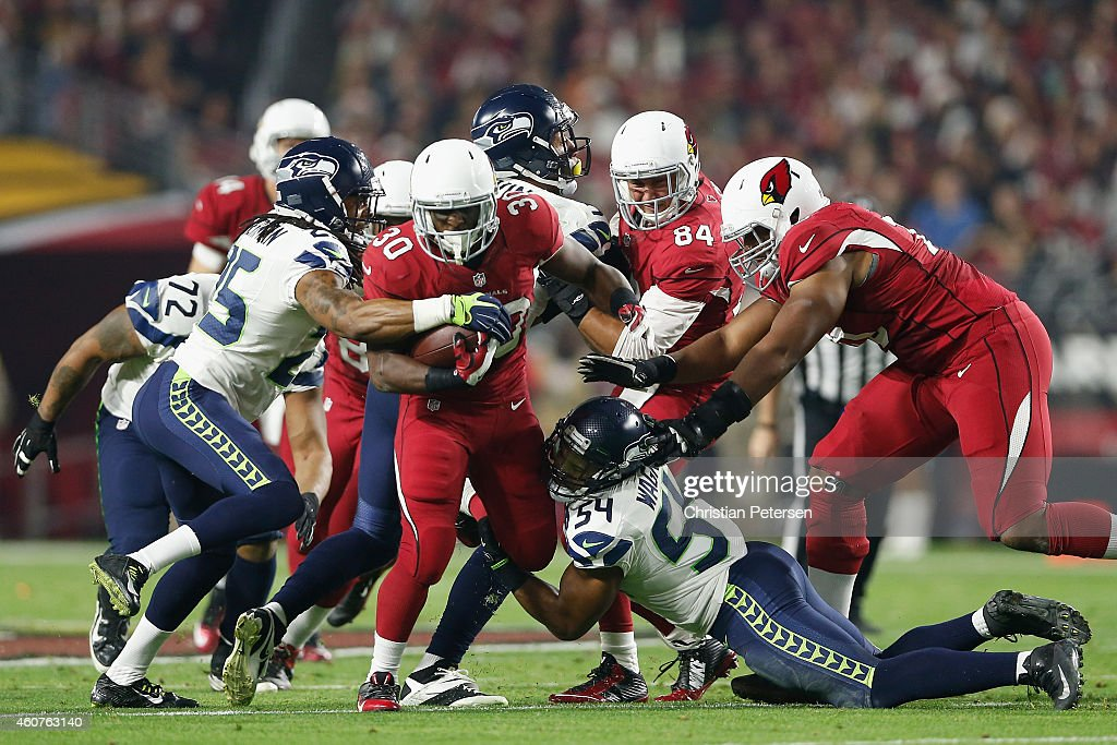 Running back <a gi-track='captionPersonalityLinkClicked' href=/galleries/search?phrase=Stepfan+Taylor&family=editorial&specificpeople=6523004 ng-click='$event.stopPropagation()'>Stepfan Taylor</a> #30 of the Arizona Cardinals rushes the football in the second quarter against the Seattle Seahawks during the NFL game at the University of Phoenix Stadium on December 21, 2014 in Glendale, Arizona.