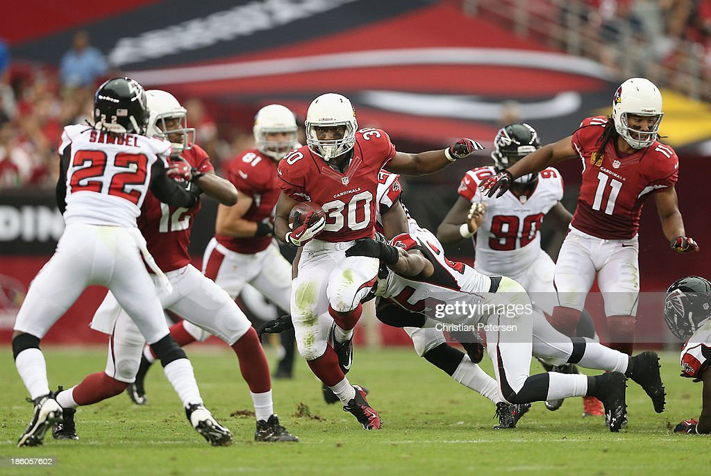 Running back <a gi-track='captionPersonalityLinkClicked' href=/galleries/search?phrase=Stepfan+Taylor&family=editorial&specificpeople=6523004 ng-click='$event.stopPropagation()'>Stepfan Taylor</a> #30 of the Arizona Cardinals rushes the football against the Atlanta Falcons during the NFL game at the University of Phoenix Stadium on October 27, 2013 in Glendale, Arizona. The Cardinals defeated the Falcons 27-13.