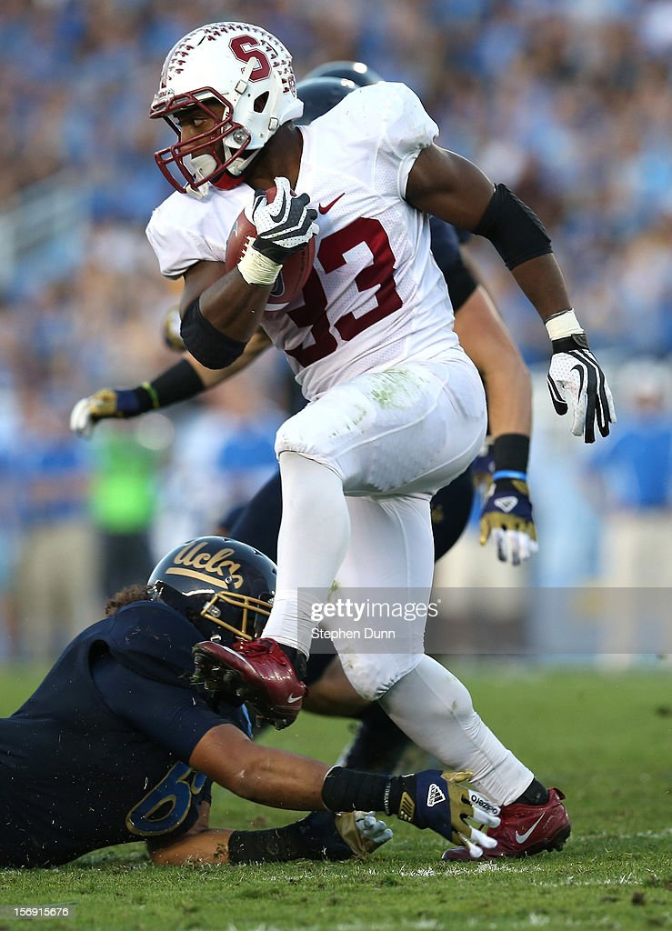 Running back Stepfan Taylor #33 of the Stanford Cardinal carries the ball against the UCLA Bruins at the Rose Bowl on October 13, 2012 in Pasadena, California. Stanford won 35-17.