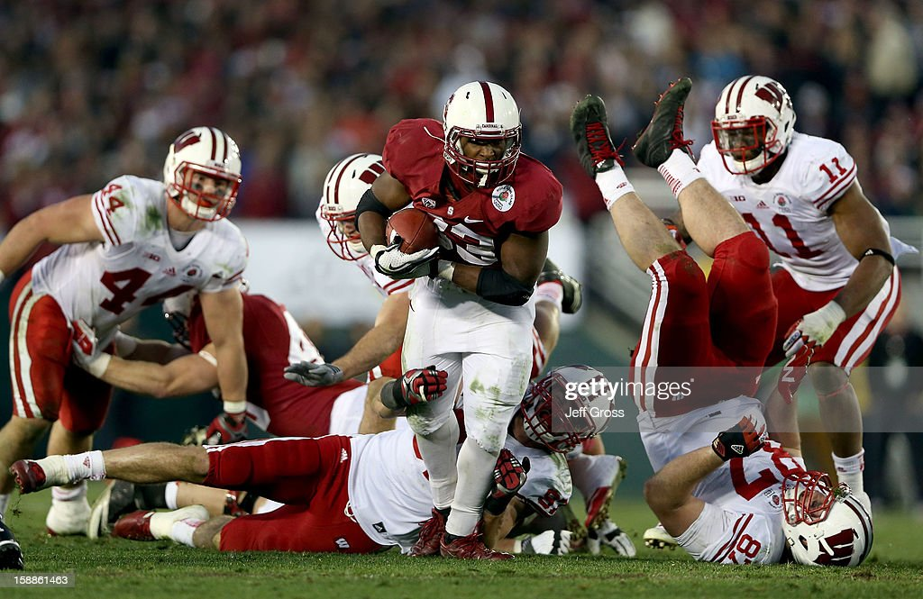 Running back <a gi-track='captionPersonalityLinkClicked' href=/galleries/search?phrase=Stepfan+Taylor&family=editorial&specificpeople=6523004 ng-click='$event.stopPropagation()'>Stepfan Taylor</a> #33 of the Stanford Cardinal runs the ball in the fourth quarter against Ethan Hemer #87 of the Wisconsin Badgers in the 99th Rose Bowl Game Presented by Vizio on January 1, 2013 at the Rose Bowl in Pasadena, California.