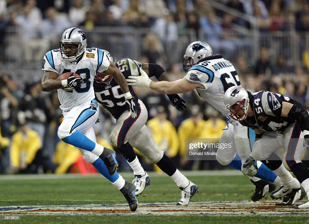 Running back Stephen Davis #48 of the Carolina Panthers runs the football against the New England Patriots during Super Bowl XXXVIII at Reliant Stadium on February 1, 2004 in Houston, Texas. The Patriots won 32-29 to claim their second Super Bowl in three years.