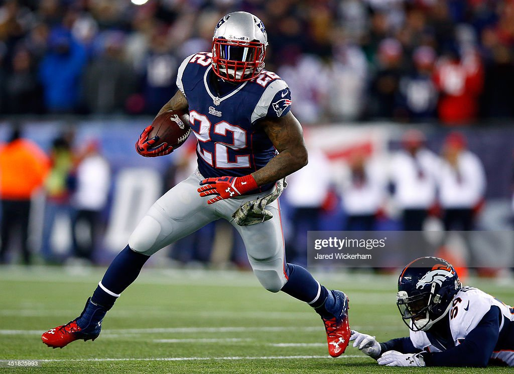 Running back <a gi-track='captionPersonalityLinkClicked' href=/galleries/search?phrase=Stevan+Ridley&family=editorial&specificpeople=4674104 ng-click='$event.stopPropagation()'>Stevan Ridley</a> #22 of the New England Patriots avoids a tackle by outside linebacker <a gi-track='captionPersonalityLinkClicked' href=/galleries/search?phrase=Danny+Trevathan&family=editorial&specificpeople=6475347 ng-click='$event.stopPropagation()'>Danny Trevathan</a> #59 of the Denver Broncos during a game at Gillette Stadium on November 24, 2013 in Foxboro, Massachusetts.