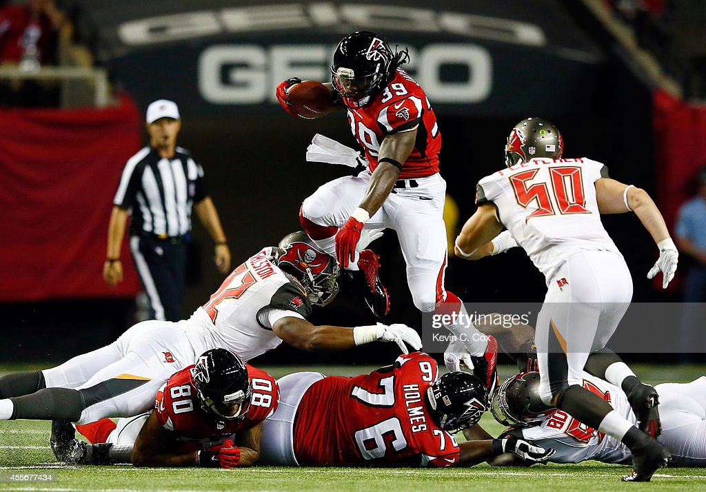 Running back Steven Jackson of the Atlanta Falcons carries the ball in the first quarter against the Tampa Bay Buccaneers during a game at the...