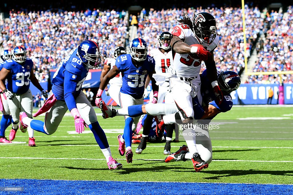 Running back Steven Jackson of the Atlanta Falcons scores a ten yard touchdown in the first quarter against the New York Giants during their game at...
