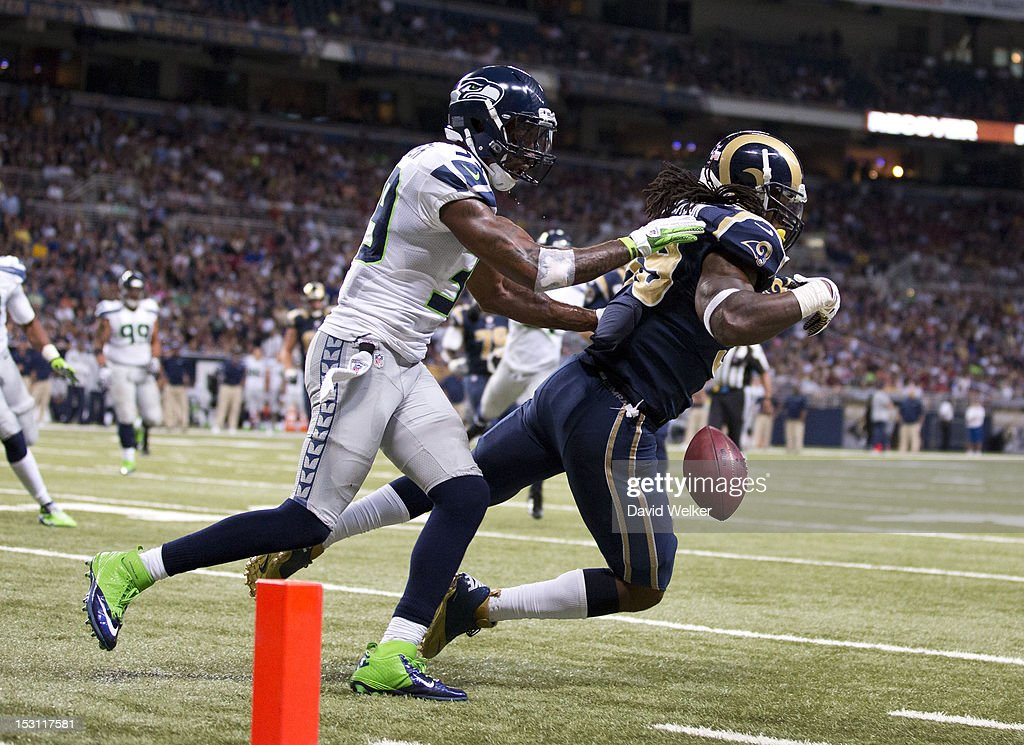 Running back Steven Jackson of the St Louis Rams drops a pass near the goal line after being hit from behind by cornerback Brandon Browner of the...