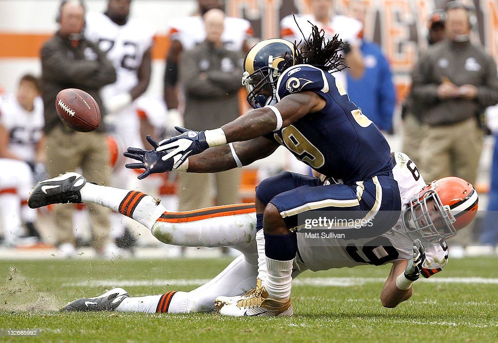 Running back Steven Jackson of the St Louis Rams fumbles the ball as he is hit by linebacker Scott Fujita of the Cleveland Browns at Cleveland Browns...