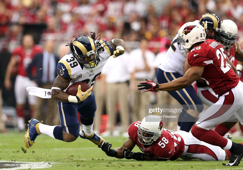 Running back <a gi-track='captionPersonalityLinkClicked' href=/galleries/search?phrase=Steven+Jackson+-+American+football-speler&family=editorial&specificpeople=15387688 ng-click='$event.stopPropagation()'>Steven Jackson</a> #39 of the St. Louis Rams is tripped up by inside linebacker Daryl Washington #58 of the Arizona Cardinals as he rushes the football during the NFL game at the University of Phoenix Stadium on November 25, 2012 in Glendale, Arizona.