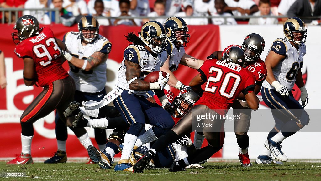 Running back <a gi-track='captionPersonalityLinkClicked' href=/galleries/search?phrase=Steven+Jackson+-+American+Football+Player&family=editorial&specificpeople=15387688 ng-click='$event.stopPropagation()'>Steven Jackson</a> #39 of the St. Louis Rams runs the ball as safety <a gi-track='captionPersonalityLinkClicked' href=/galleries/search?phrase=Ronde+Barber&family=editorial&specificpeople=209238 ng-click='$event.stopPropagation()'>Ronde Barber</a> #20 of the Tampa Bay Buccaneers closes in for the tackle during the game at Raymond James Stadium on December 23, 2012 in Tampa, Florida.