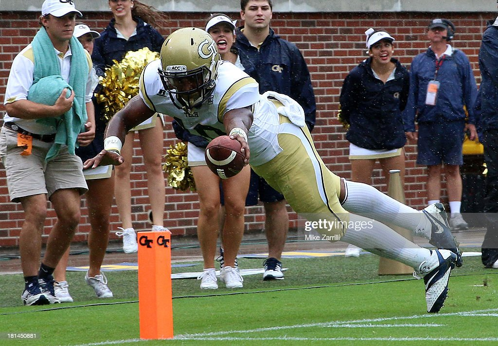 Running back Synjyn Days #10 of the Georgia Tech Yellow Jackets stretches for the goal post and just misses a touchdown during the game against the North Carolina Tar Heels at Bobby Dodd Stadium at Historic Grant Field on September 21, 2013 in Atlanta, Georgia.