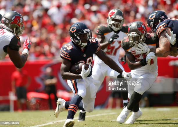 Running back Tarik Cohen of the Chicago Bears carries the ball for several yards during the first quarter of an NFL football game against the Tampa...