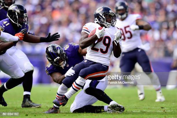 Running Back Tarik Cohen of the Chicago Bears carries the ball in the third quarter against the Baltimore Ravens at MT Bank Stadium on October 15...