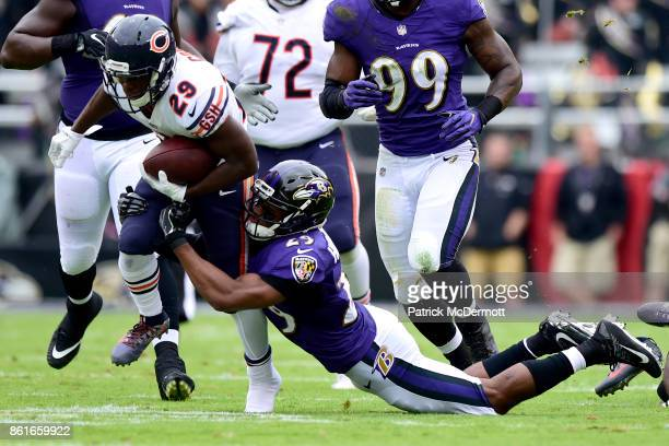 Running Back Tarik Cohen of the Chicago Bears carries the ball against Marlon Humphrey of the Baltimore Ravens in the first quarter at MT Bank...