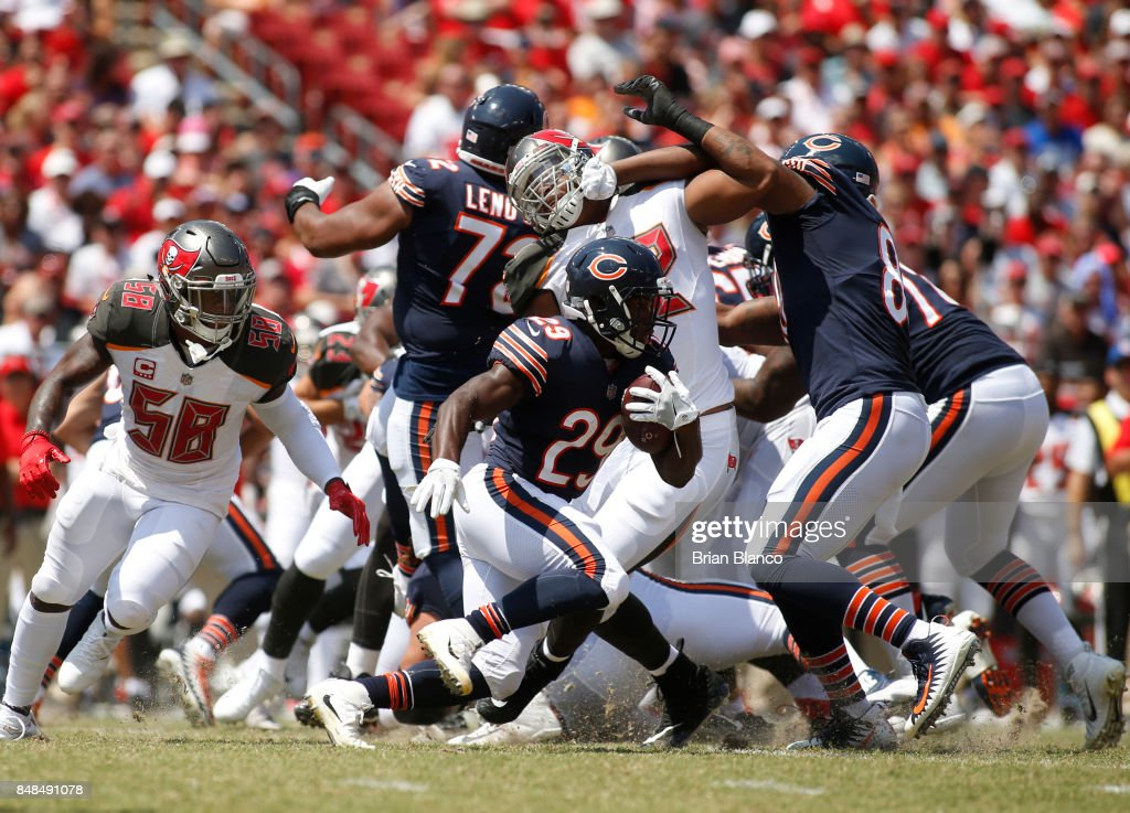 Running back Tarik Cohen #29 of the Chicago Bears evades middle linebacker Kwon Alexander #58 of the Tampa Bay Buccaneers in the first quarter of an NFL football game on September 17, 2017 at Raymond James Stadium in Tampa, Florida.