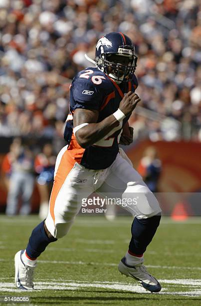 Running back Tatum Bell of the Denver Broncos carries the ball against the Carolina Panthers during the game at Invesco Field on October 10 2004 at...