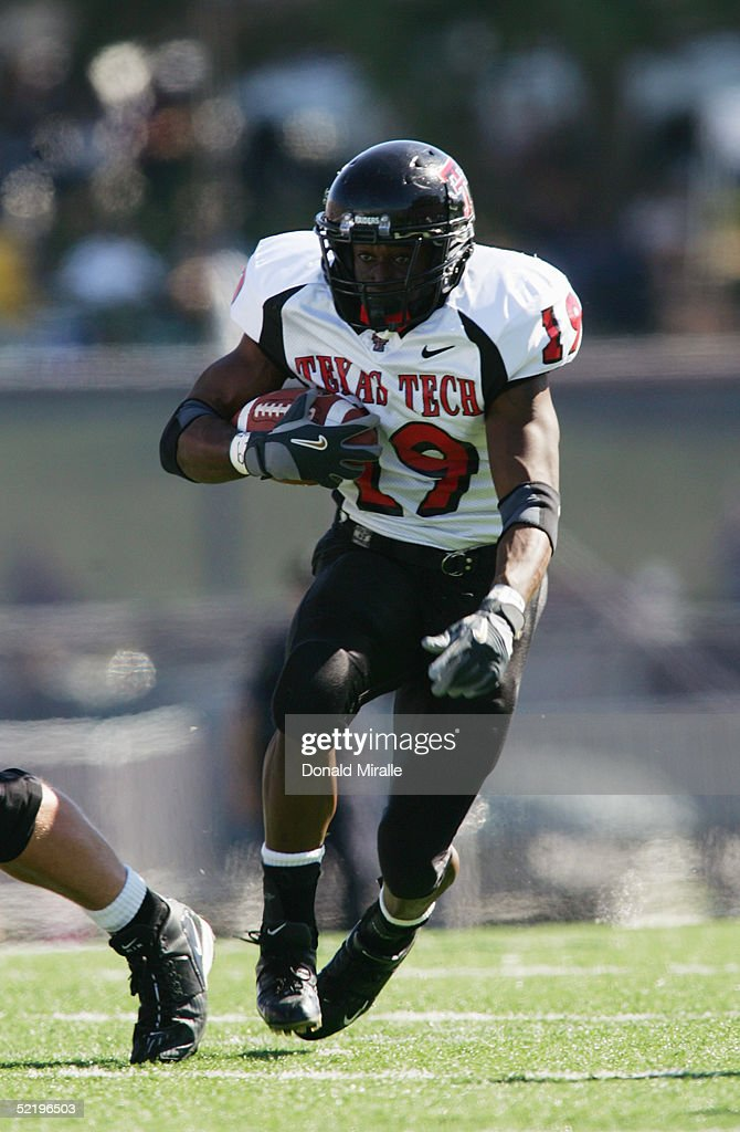 Running back Taurean Henderson of the Texas Tech Red Raiders runs upfield against the University of Kansas Jayhawks during the Big 12 Conference Game...