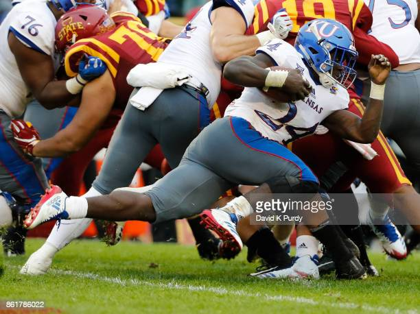 Running back Taylor Martin of the Kansas Jayhawks dives for yards in the second half of play against the Iowa State Cyclones at Jack Trice Stadium on...