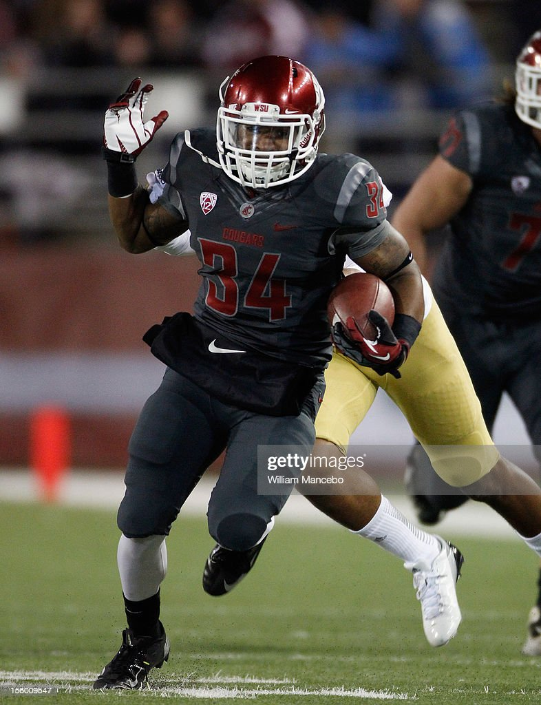 Running back Teondray Caldwell #34 of the Washington State Cougars carries the ball during the first half of the game against the UCLA Bruins at Martin Stadium on November 10, 2012 in Pullman, Washington.