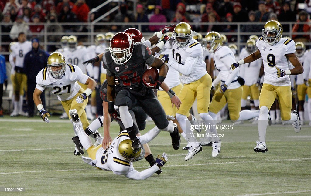 Running back Teondray Caldwell #34 of the Washington State Cougars carries the ball during the game against the UCLA Bruins at Martin Stadium on November 10, 2012 in Pullman, Washington.