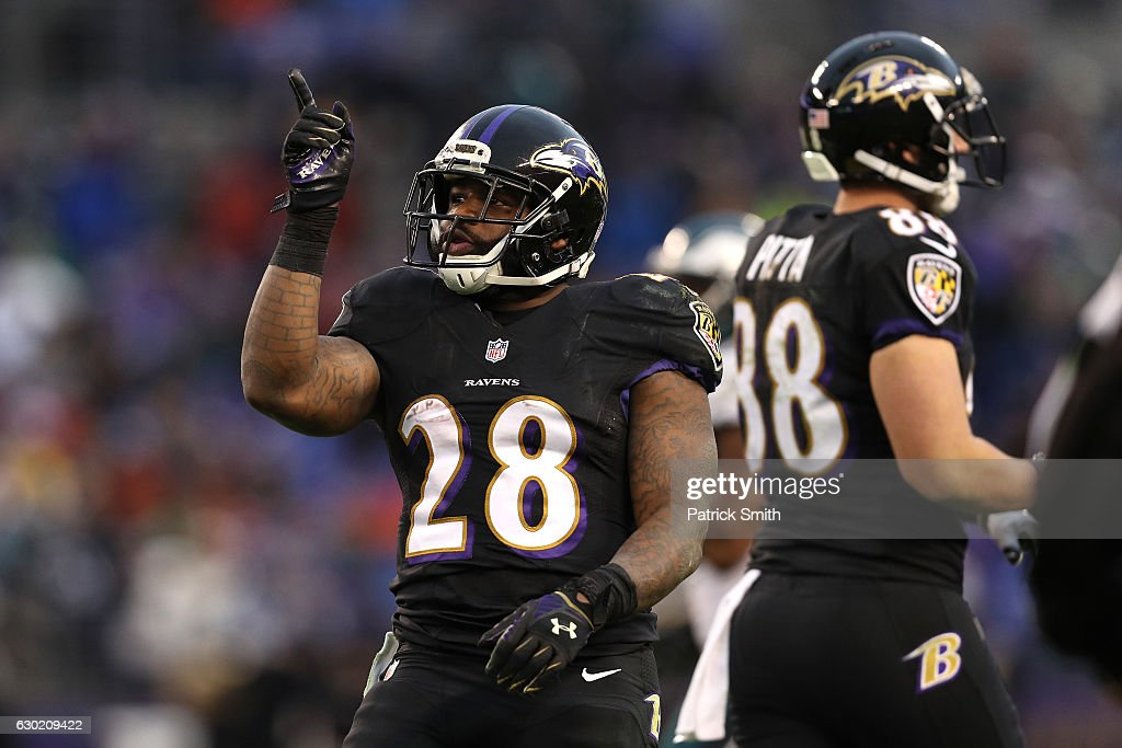 74a53f387 ... Running back Terrance West 28 of the Baltimore Ravens reacts after a  play in the ...