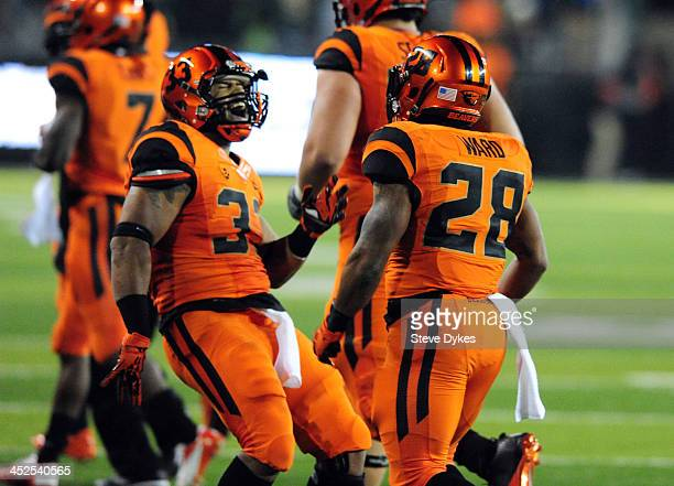 Running back Terron Ward of the Oregon State Beavers celebrates with fullback Tyler Anderson after scoring a touchdown during the second quarter of...