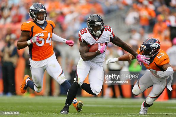 Running back Tevin Coleman of the Atlanta Falcons catches a pass and runs for a touchdown in the third quarter of the game against the Denver Broncos...