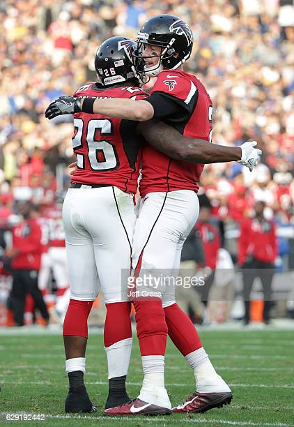 Running back Tevin Coleman of the Atlanta Falcons is congratulated by quarterback Matt Ryan after scoring a touchdown against the Los Angeles Rams in...