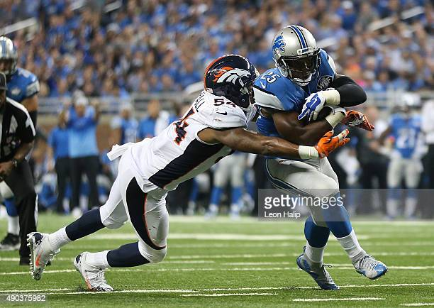Running back Theo Riddick of the Detroit Lions is tackled by inside linebacker Brandon Marshall of the Denver Broncos on September 27 2015 at Ford...