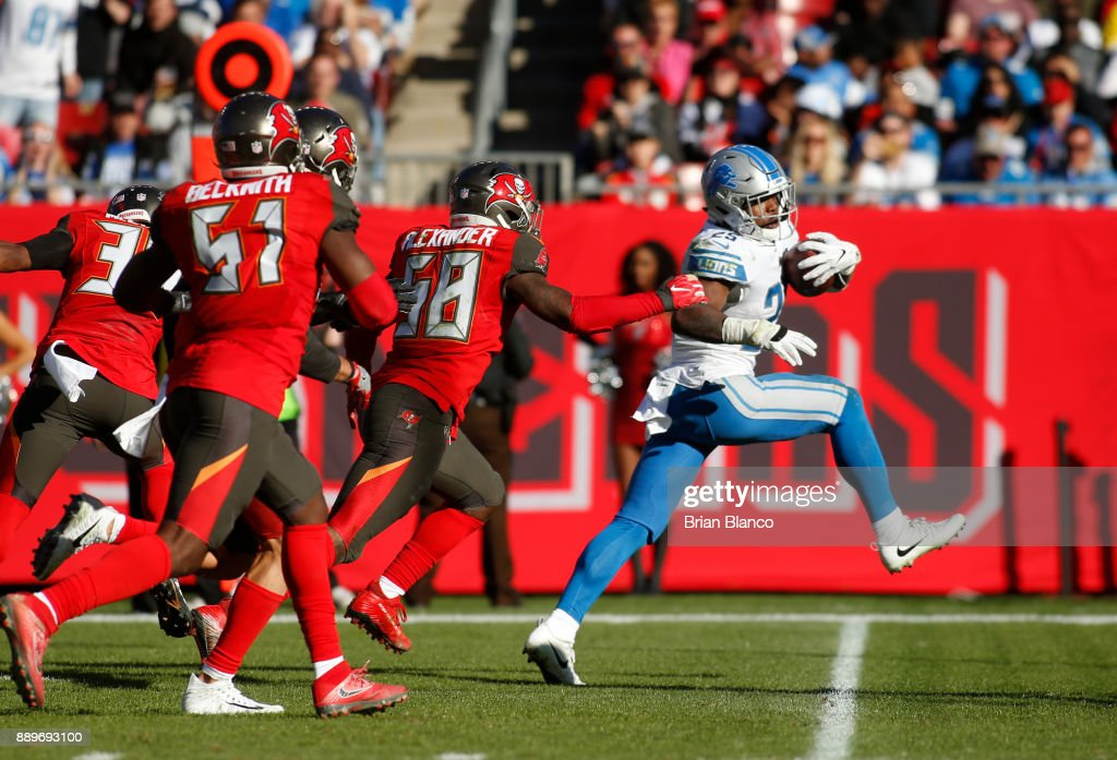Running back Theo Riddick #25 of the Detroit Lions slips a tackle by middle linebacker Kwon Alexander #58 of the Tampa Bay Buccaneers as he rushes for a 16-yard touchdown during the third quarter of an NFL football game on December 10, 2017 at Raymond James Stadium in Tampa, Florida.