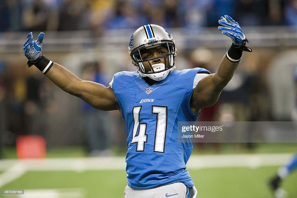 Running back <a gi-track='captionPersonalityLinkClicked' href=/galleries/search?phrase=Theo+Riddick&family=editorial&specificpeople=6235084 ng-click='$event.stopPropagation()'>Theo Riddick</a> #41 of the Detroit Lions tries to rev up the crown prior to kick off against the Baltimore Ravens during the first half at Ford Field on December 16, 2013 in Detroit, Michigan.