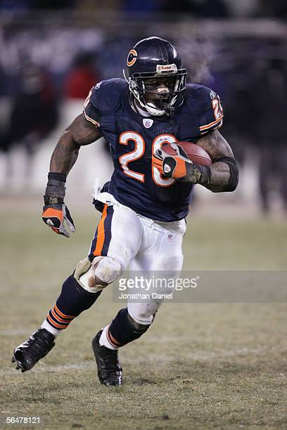 Running back Thomas Jones of the Chicago Bears carries the ball against the Atlanta Falcons at Soldier Field on December 18 2005 in Chicago Illinois...