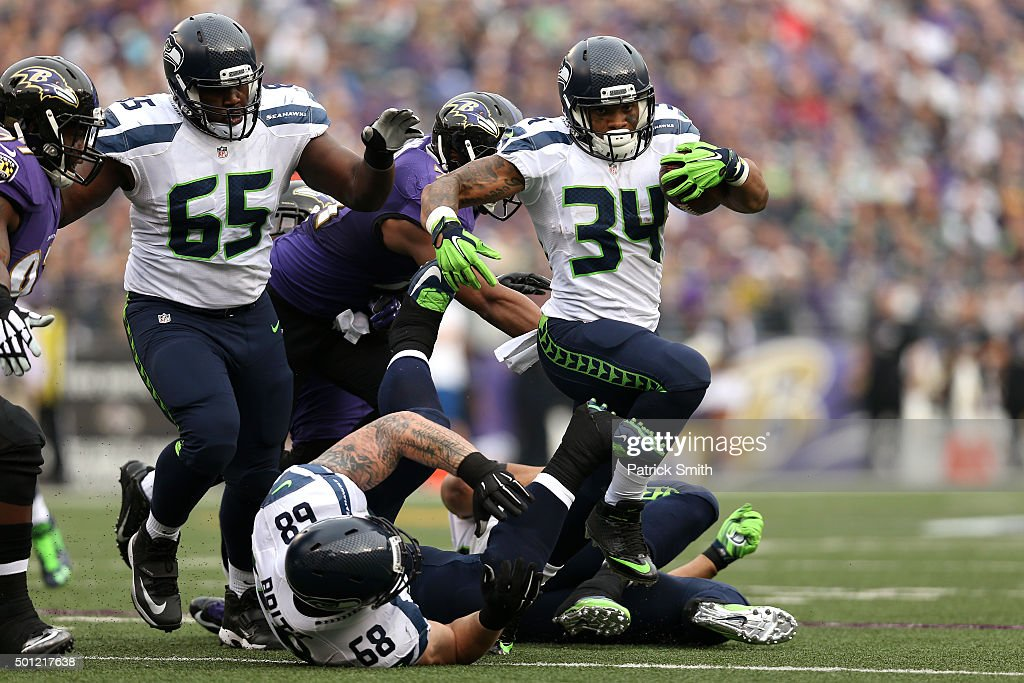 Running back Thomas Rawls #34 of the Seattle Seahawks carries the ball past inside linebacker Daryl Smith #51 of the Baltimore Ravens in the first quarter at M&T Bank Stadium on December 13, 2015 in Baltimore, Maryland.