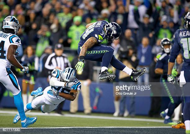 Running back Thomas Rawls of the Seattle Seahawks leaps into the endzone for a touchdown against the Carolina Panthers at CenturyLink Field on...