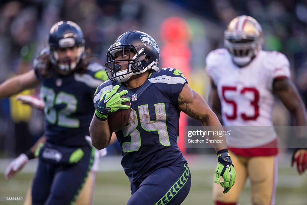 Running back Thomas Rawls #34 of the Seattle Seahawks runs with the ball after a reception on his way to score a touchdown during teh second half of a football game against the San Francisco 49ers at CenturyLink Field on November 22, 2015 in Seattle, Washington. The Seahawks won the game 29-13.