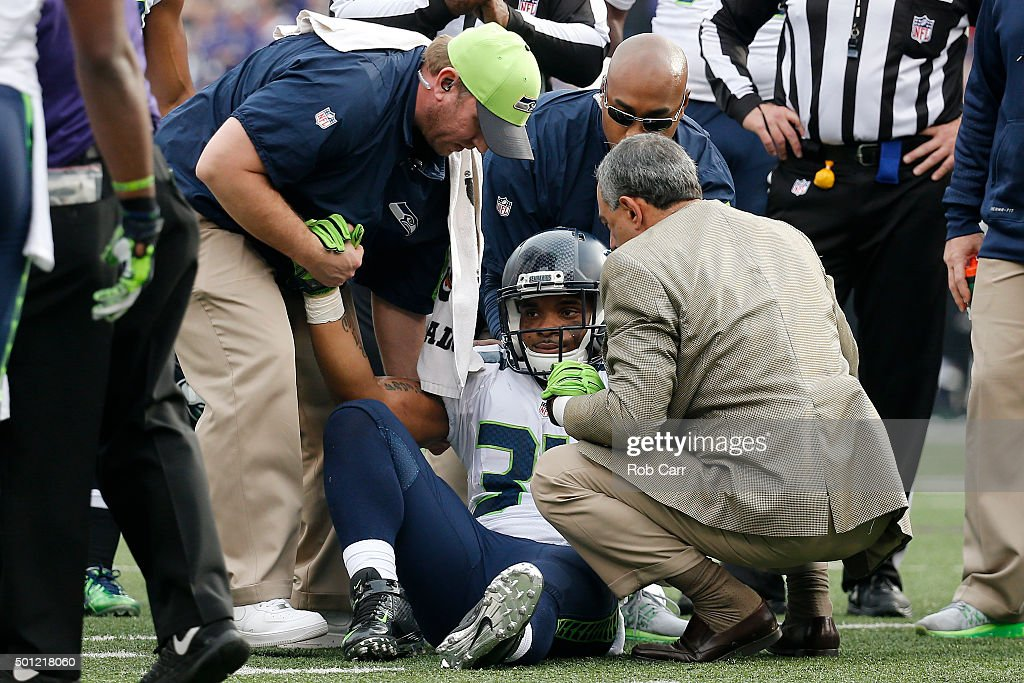 Running back Thomas Rawls #34 of the Seattle Seahawks sits on the field injured against the Baltimore Ravens in the first quarter at M&T Bank Stadium on December 13, 2015 in Baltimore, Maryland.