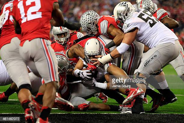 Running back Thomas Tyner of the Oregon Ducks gets stopped at the 1 yard line in the second quarter against the Ohio State Buckeyes during the...