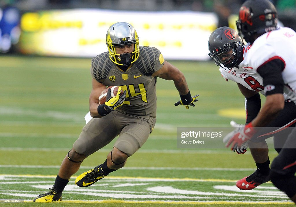 Running back Thomas Tyner #24 of the Oregon Ducks runs with the ball during the fourth quarter of the game against the Utah Utes at Autzen Stadium on November 16, 2013 in Eugene, Oregon.
