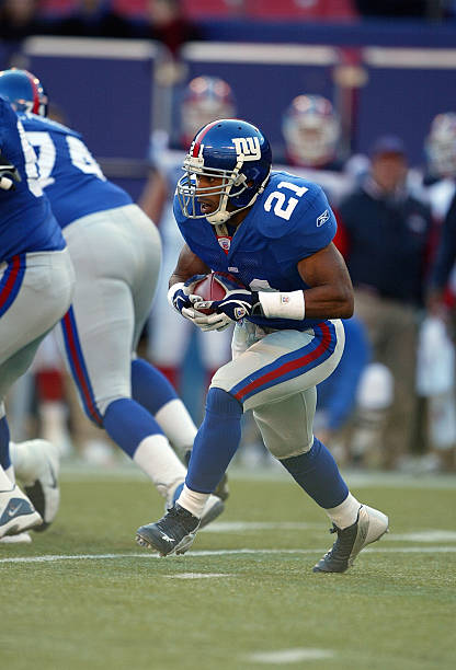 765bc0146 ... Running back Tiki Barber 21 of the New York Giants carries the ball  against the ...