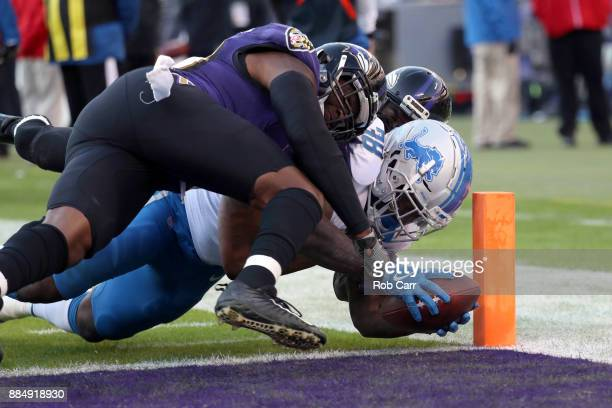 Running Back Tion Green of the Detroit Lions rushes for a touchdown in the third quarter against the Baltimore Ravens at MT Bank Stadium on December...