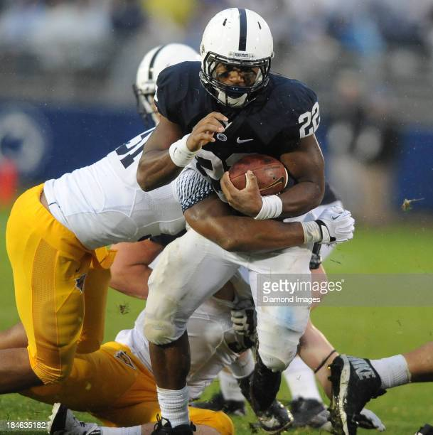Running back TJ Rhattigan of the Penn State Nittany LIons runs the football during a game against the Kent State Golden Flashes at Beaver Stadium in...