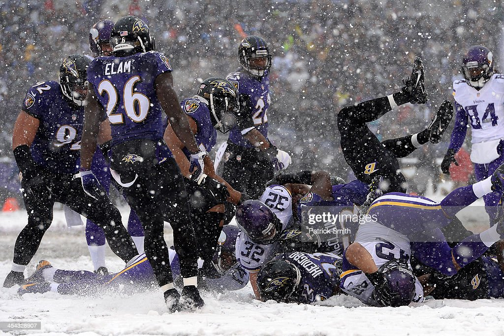 Running back <a gi-track='captionPersonalityLinkClicked' href=/galleries/search?phrase=Toby+Gerhart&family=editorial&specificpeople=2968082 ng-click='$event.stopPropagation()'>Toby Gerhart</a> #32 of the Minnesota Vikings is tackled by Baltimore Ravens defenders in the first quarter at M&T Bank Stadium on December 8, 2013 in Baltimore, Maryland. The Baltimore Ravens won, 29-26.
