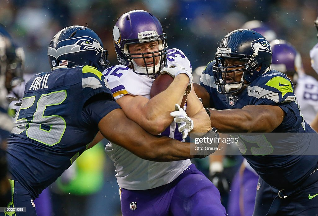 Running back <a gi-track='captionPersonalityLinkClicked' href=/galleries/search?phrase=Toby+Gerhart&family=editorial&specificpeople=2968082 ng-click='$event.stopPropagation()'>Toby Gerhart</a> #32 of the Minnesota Vikings rushes against defensive end <a gi-track='captionPersonalityLinkClicked' href=/galleries/search?phrase=Cliff+Avril&family=editorial&specificpeople=2237705 ng-click='$event.stopPropagation()'>Cliff Avril</a> #56 of the Seattle Seahawks at CenturyLink Field on November 17, 2013 in Seattle, Washington. The Seahawks defeated the Vikings 41-20.