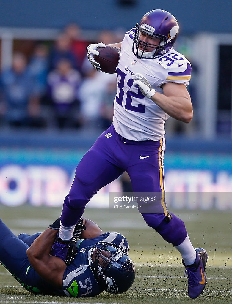 Running back <a gi-track='captionPersonalityLinkClicked' href=/galleries/search?phrase=Toby+Gerhart&family=editorial&specificpeople=2968082 ng-click='$event.stopPropagation()'>Toby Gerhart</a> #32 of the Minnesota Vikings rushes against middle linebacker <a gi-track='captionPersonalityLinkClicked' href=/galleries/search?phrase=Bobby+Wagner+-+American+Football+Player&family=editorial&specificpeople=9205520 ng-click='$event.stopPropagation()'>Bobby Wagner</a> #54 of the Seattle Seahawks at CenturyLink Field on November 17, 2013 in Seattle, Washington. The Seahawks defeated the Vikings 41-20.