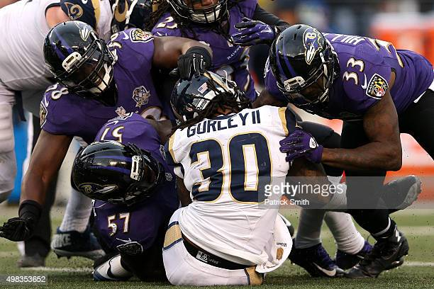 Running back Todd Gurley of the St Louis Rams is tackled by inside linebacker CJ Mosley of the Baltimore Ravens center Jeremy Zuttah of the Baltimore...