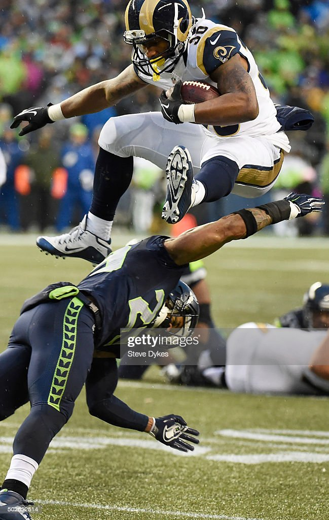 Running back Todd Gurley #30 of the St. Louis Rams leaps over free safety Earl Thomas #29 of the Seattle Seahawks during the fourth quarter of the game at CenturyLink Field on December 27, 2015 in Seattle, Washington. The Rams won the game 23-17.