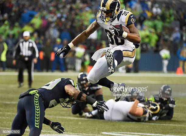 Running back Todd Gurley of the St Louis Rams leaps over free safety Earl Thomas of the Seattle Seahawks during the fourth quarter of the game at...