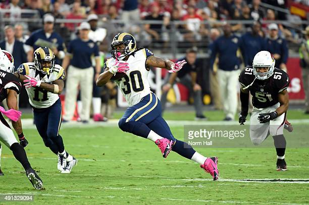 Running back Todd Gurley of the St Louis Rams runs up field during the third quarter of the NFL game against the Arizona Cardinals at University of...