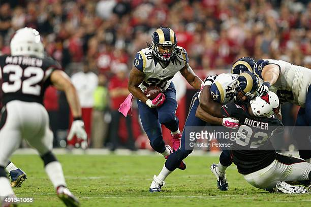 Running back Todd Gurley of the St Louis Rams runs up field during the third quarter of the NFL game against the Arizona Cardinals at the University...
