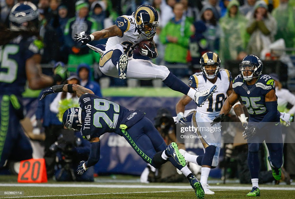 Running back Todd Gurley #30 of the St. Louis Rams rushes against free safety Earl Thomas #29 of the Seattle Seahawks at CenturyLink Field on December 27, 2015 in Seattle, Washington. The Rams defeated the Seahawks 23-17.