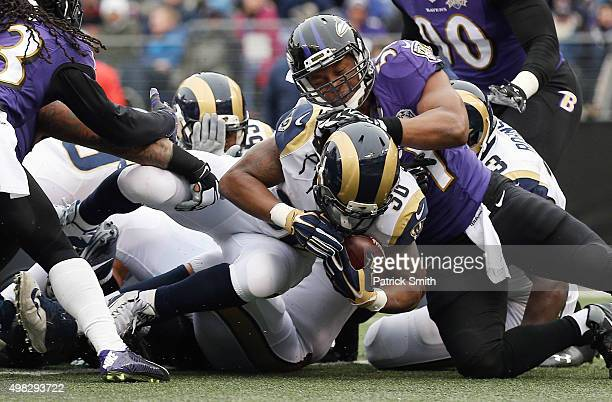 Running back Todd Gurley of the St Louis Rams score a first quarter touchdown past inside linebacker Daryl Smith of the Baltimore Ravens at MT Bank...